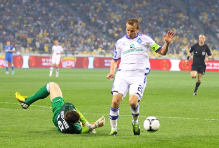 gusev: KYIV, UKRAINE - APRIL 27, 2013  Oleg Gusev of FC Dynamo Kyiv  in White  fights for a ball with goalkeeper Jan Lastuvka of FC Dnipro during their Ukraine Championship game on April 27, 2013 in Kyiv, Ukraine