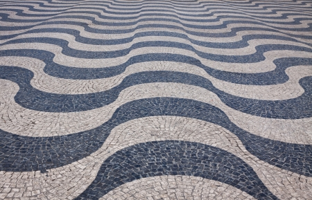 Typical portuguese cobblestone pavement on the street of Lisbon, Portugal photo
