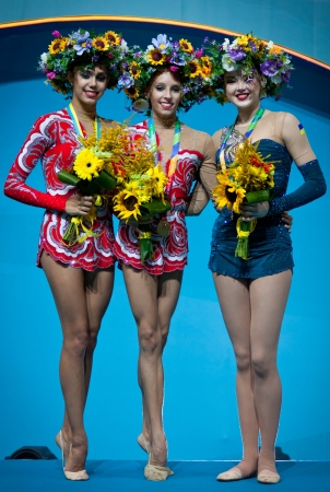 KYIV, UKRAINE - AUGUST 29, 2013  Margarita Mamun  L , Yana Kudryavtseva  C  and Alina Maksymenko - medallists of 32nd Rhythmic Gymnastics World Championship  Clubs individual competition  stand at podium on August 29, 2013 in Kyiv, Ukraine Stock Photo - 22130816