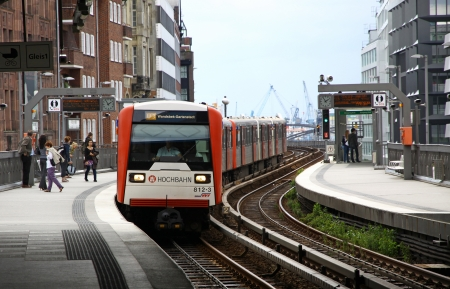 u bahn: HAMBURG, GERMANY - JULY 30, 2012  Train arrives at Baumwall U-Bahn Station on July 30, 2012 in Hamburg, Germany  Hamburg U-Bahn  rapid transit system  was opened in 1912 and comprises four lines with a length of 105 km in 2012