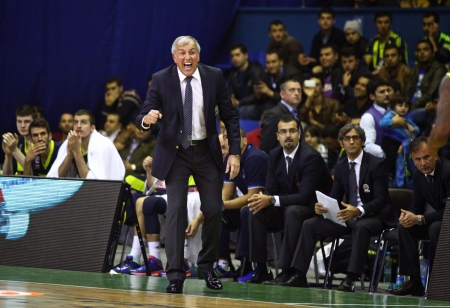 KYIV, UKRAINE - OCTOBER 17, 2013  Head coach Zeljko Obradovic of Fenerbahce Ulker looks on during Turkish Airlines Euroleague game against Budivelnik on October 17, 2013 in Kyiv, Ukraine Stock Photo - 23136653