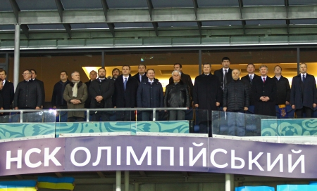 anthem: KYIV, UKRAINE - NOVEMBER 15, 2013  President of Ukraine Victor Yanukovich and other ukrainian politics listen national anthem before FIFA World Cup 2014 qualifier game against France on November 15, 2013 in Kyiv, Ukraine Editorial