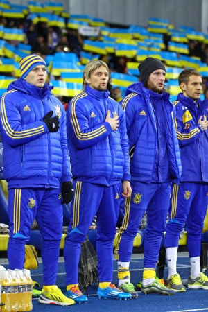 gusev: KYIV, UKRAINE - NOVEMBER 15, 2013  Ukraine National football team players listen the national anthems before FIFA World Cup 2014 qualifier game against France on November 15, 2013 in Kyiv, Ukraine