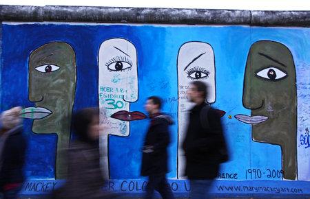 BERLIN - NOVEMBER 10, 2013  People walking near East Side Gallery on November 10, 2013 in Berlin, Germany  It