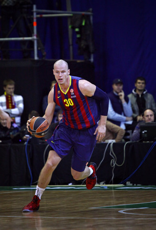 KYIV, UKRAINE - NOVEMBER 14, 2013  Maciej Lampe of FC Barcelona controls a ball during Turkish Airlines Euroleague basketball game against Budivelnik Kyiv