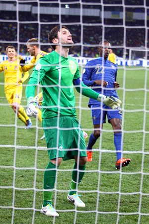 reacts: KYIV, UKRAINE - NOVEMBER 15, 2013  Goalkeeper Hugo Lloris of France reacts after missed a goal during FIFA World Cup 2014 play-off game against Ukriane Editorial