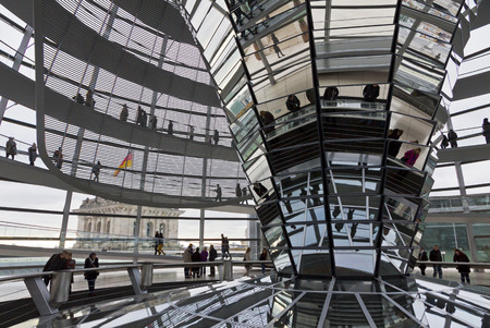BERLIN, GERMANY - NOVEMBER 10, 2013  People walking inside the Reichstag Dome  It is a glass dome constructed on the top of the Reichstag  Bundestag  building, designed by architect Norman Foster