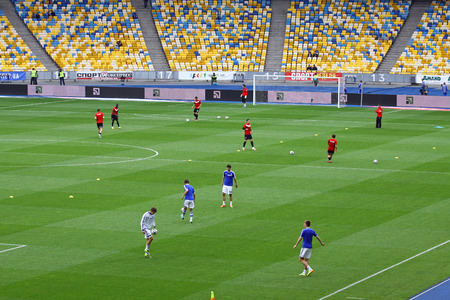 KYIV, UKRAINE - MAY 18, 2014  Players warm-up during training session before Ukraine Championship game between FC Dynamo Kyiv and FC Zorya Luhansk at Olympic stadium in Kyiv