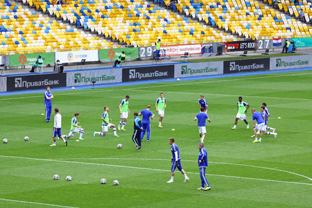 KYIV, UKRAINE - MAY 18, 2014  FC Dynamo Kyiv players warm-up during training session before Ukraine Championship game against FC Zorya Luhansk at Olympic stadium in Kyiv