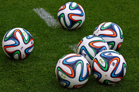 KYIV, UKRAINE - MAY 18, 2014  Official FIFA 2014 World Cup balls  Brazuca  on the grass during Ukraine Championship game between FC Dynamo Kyiv and FC Zorya Luhansk at Olympic stadium in Kyiv