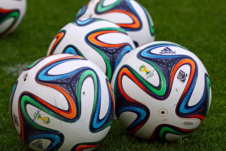 KYIV, UKRAINE - MAY 18, 2014  Close-up official FIFA 2014 World Cup balls  Brazuca  on the grass during Ukraine Championship game between FC Dynamo Kyiv and FC Zorya Luhansk at Olympic stadium in Kyiv