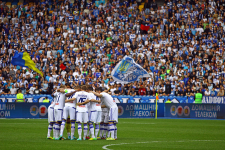KYIV, UKRAINE - MAY 18, 2014  FC Dynamo Kyiv players chear each other up during Ukraine Championship game against FC Zorya Luhansk at Olympic stadium in Kyiv