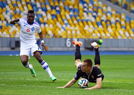 KYIV, UKRAINE - MAY 18, 2014  Brown Ideye of Dynamo Kyiv  L  fights for a ball with FC Zorya Luhansk player during their Ukraine Championship game at Olympic stadium in Kyiv