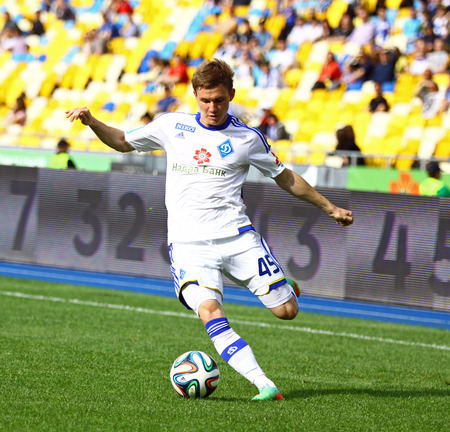 KYIV, UKRAINE - MAY 18, 2014  Vladyslav Kalytvyntsev of Dynamo Kyiv controls a ball during Ukraine Championship game against FC Zorya Luhansk at Olympic stadium in Kyiv