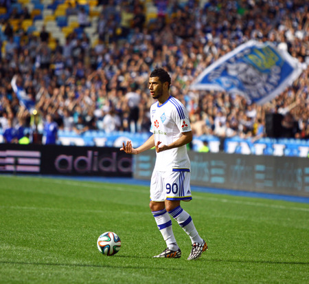 luhansk: KYIV, UKRAINE - MAY 18, 2014  Younes Belhanda of Dynamo Kyiv controls a ball during Ukraine Championship game against FC Zorya Luhansk at Olympic stadium in Kyiv