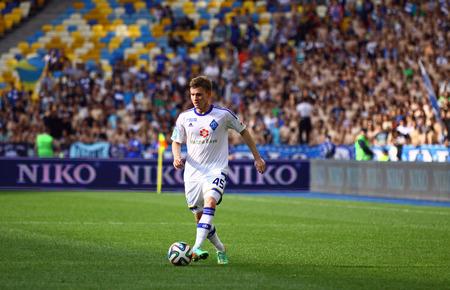 luhansk: KYIV, UKRAINE - MAY 18, 2014  Vladyslav Kalytvyntsev of Dynamo Kyiv controls a ball during Ukraine Championship game against FC Zorya Luhansk at Olympic stadium in Kyiv