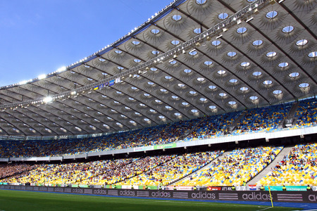 luhansk: KYIV, UKRAINE - MAY 18, 2014  Tribunes of Olympic stadium  NSC Olimpiyskyi  during Ukraine Championship game between FC Dynamo Kyiv and FC Zorya Luhansk Editorial