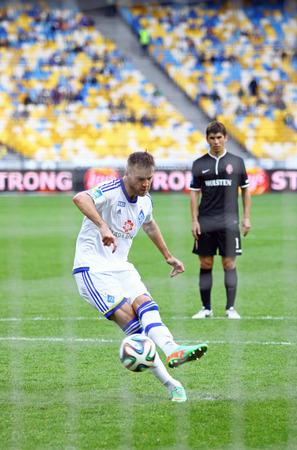 KYIV, UKRAINE - MAY 18, 2014  Andriy Yarmolenko of Dynamo Kyiv scores a penalty during Ukraine Championship game against FC Zorya Luhansk at Olympic stadium in Kyiv
