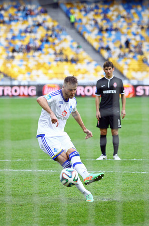 luhansk: KYIV, UKRAINE - MAY 18, 2014  Andriy Yarmolenko of Dynamo Kyiv scores a penalty during Ukraine Championship game against FC Zorya Luhansk at Olympic stadium in Kyiv Editorial