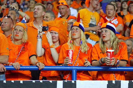 KHARKIV, UKRAINE - 13 June, 2012  Dutch fans show their support at Kharkiv Arena during UEFA EURO 2012 game between Netherlands and Germany