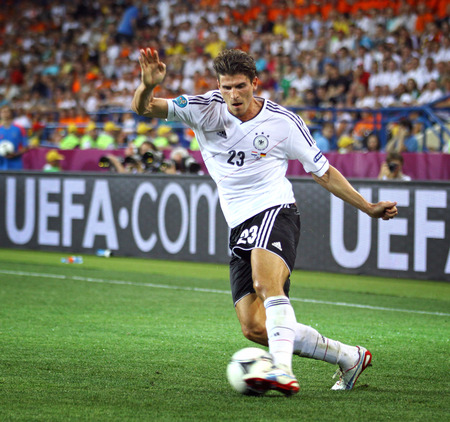 KHARKIV, UKRAINE - 13 June, 2012  Mario Gomez of Germany controls a ball during UEFA EURO 2012 game against Netherlands