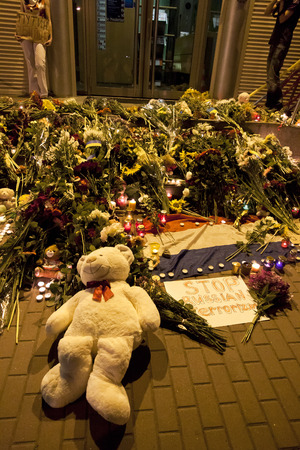 KYIV, UKRAINE - JULY 17, 2014  People place flowers at Dutch embassy in Kyiv after Malaysia Airlines Boeing 777 originating in Amsterdam crashed in Eastern Ukraine