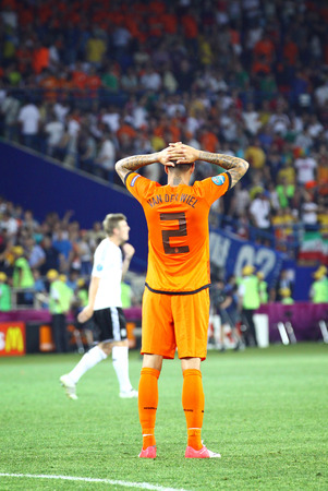 reacts: KHARKIV, UKRAINE - 13 June, 2012  Gregory van der Wiel reacts after Netherlands lost against Germany in their UEFA EURO 2012 game on Kharkiv Arena