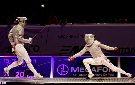 KYIV, UKRAINE - APRIL 13, 2012  Olga Zhovnir of Ukraine  L  fights against Dina Galiakbarova of Russia during Womens Sabre Team final match of the World Fencing Championships