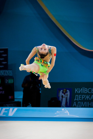 KYIV, UKRAINE - AUGUST 30, 2013  Senyue Deng of China performs during 32nd Rhythmic Gymnastics World Championship  Individual All-Around competition  Editorial