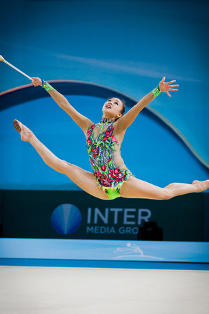 deng: KYIV, UKRAINE - AUGUST 30, 2013: Senyue Deng of China performs during 32nd Rhythmic Gymnastics World Championship (Individual All-Around competition) Editorial