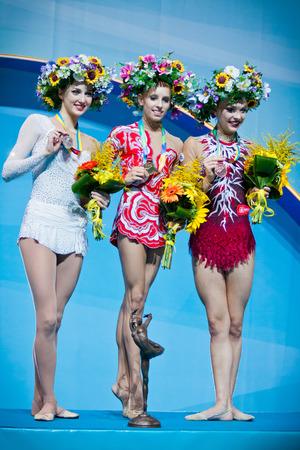 KYIV, UKRAINE - AUGUST 30, 2013: Ganna Rizatdinova (L), Yana Kudryavtseva (C) and Melitina Staniouta - medallists of 32nd Rhythmic Gymnastics World Championship (Individual All-Around competition)