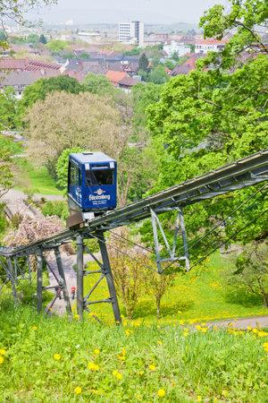railtrack: FREIBURG, GERMANY - MAY 5, 2013: The Schlossbergbahn (English: Castle Hill Railway) is a funicular railway in Freiburg im Breisgau city, Germany. It links the city centre with the Schlossberg hill