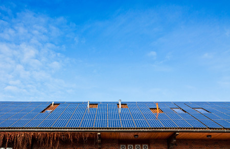 Solar panels installed on the roof of building photo