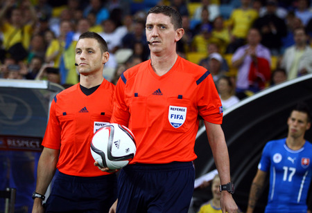 alan: KYIV, UKRAINE - SEPTEMBER 8, 2014: Referee Craig Thomson of Scotland (C) and his assistant Alan Mulvanny (L) go to the pitch before UEFA EURO 2016 Qualifying game between Ukraine and Slovakia