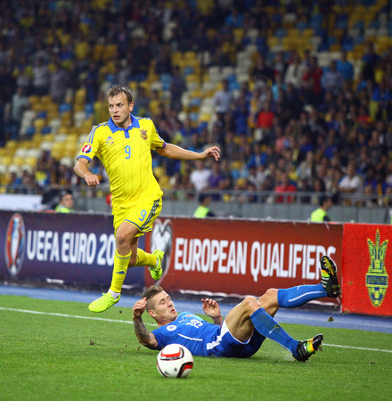 gusev: KYIV, UKRAINE - SEPTEMBER 8, 2014: Oleh Gusev of Ukraine (in Yellow) fights for a ball with Juraj Kucka of Slovakia during their UEFA EURO 2016 Qualifying game Editorial