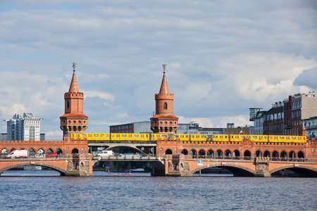 u bahn: Oberbaumbrucke bridge across the Spree river in Berlin, Germany. It is the longest bridge of Berlin