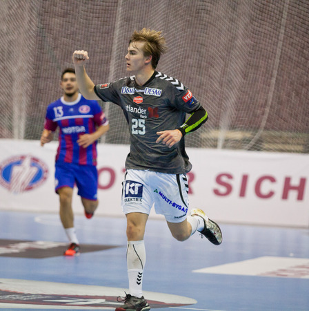 reacts: KYIV, UKRAINE - OCTOBER 18, 2014: Christian Jensen of Aalborg reacts after scored against Motor during their European Handball Champions League game