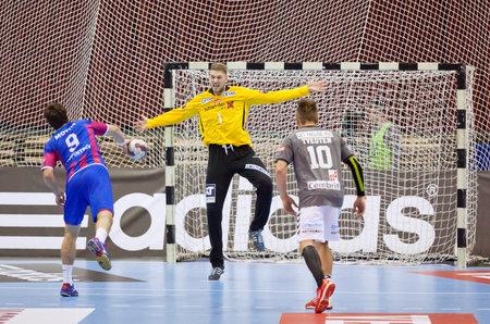 KYIV, UKRAINE - OCTOBER 18, 2014: Oleg Skopintsev of Motor (#9) throws the penalty kick during European Handball Champions League game against Aalborg Editorial