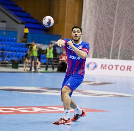 KYIV, UKRAINE - OCTOBER 18, 2014: Inal Aflitulin of Motor controls a ball during European Handball Champions League game against Aalborg