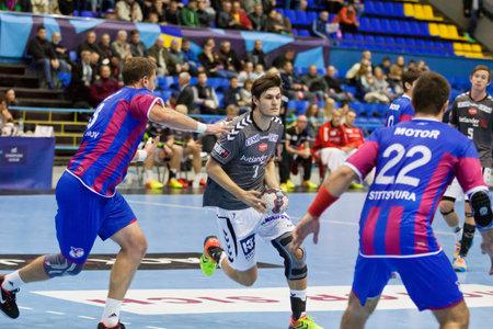 KYIV, UKRAINE - OCTOBER 18, 2014: Martin Larsen of Aalborg (C) controls a ball during European Handball Champions League game against Motor Editorial