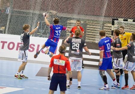 KYIV, UKRAINE - OCTOBER 18, 2014: Sergiy Onufrienko of Motor (#33) attacks during European Handball Champions League game against Aalborg