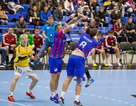 KYIV, UKRAINE - OCTOBER 18, 2014: Motor handball players (in red-blue) play the match of European Handball Champions League against Aalborg