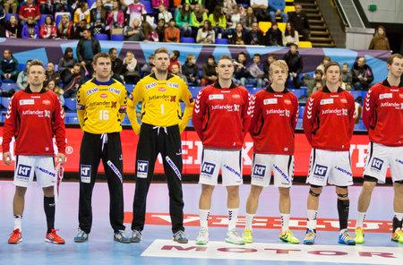 KYIV, UKRAINE - OCTOBER 18, 2014: Handball players of Aalborg team listen the anthem before European Handball Champions League game against Motor Editorial