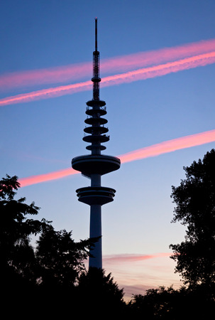 hertz: HAMBURG, GERMANY - JUNE 25, 2014: Hamburg Television tower (Heinrich-Hertz-Turm) after sunset. Tower named after the German physicist and Hamburg-born Heinrich Hertz is a famous landmark of Hamburg