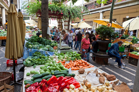 FUNCHAL, PORTUGAL - JUNE 14, 2013: People visit the famous market Mercado dos Lavradores in Funchal, capital city of Madeira island, Portugal
