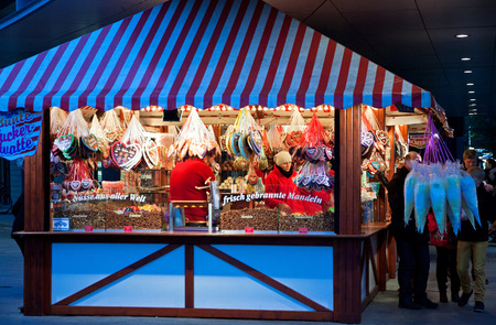 BERLIN, GERMANY - NOVEMBER 8, 2013: Sales of traditional Christmas sweets on the Christmas fair at Potsdamer Platz in Berlin