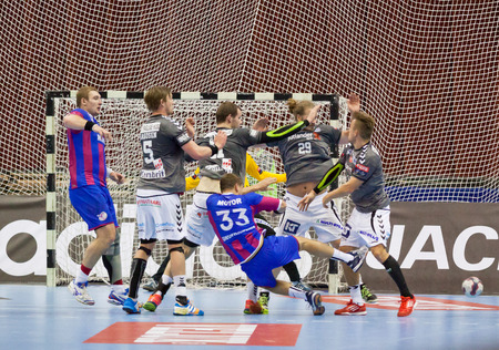 KYIV, UKRAINE - OCTOBER 18, 2014: European Handball Champions League game between Motor (Ukraine) (in red-blue) and Aalborg (Denmark) (in grey)