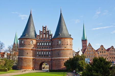 The Holsten Gate (Holstentor) in Lubeck old town, Schleswig-Holstein region, Germany