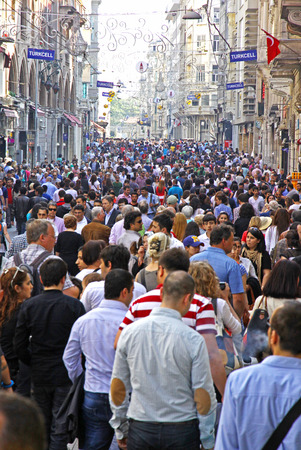 ISTANBUL, TURKEY - MAY 5, 2012: People walking on Istiklal street in Istanbul. It is the most famous street of the Turkish capital city, visited by nearly 3 million people in a single weekends day