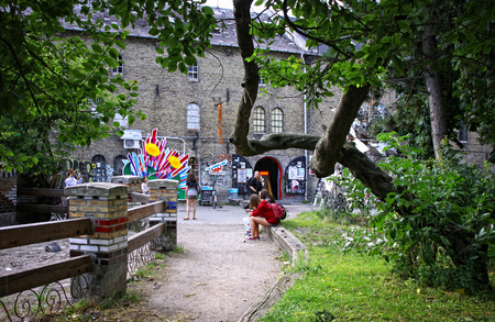hectares: COPENHAGEN, DENMARK - JULY 28, 2012: Christiania, also known as Freetown Christiania is a self-proclaimed autonomous neighbourhood, covering 34 hectares in the borough of Christianshavn in Copenhagen Editorial